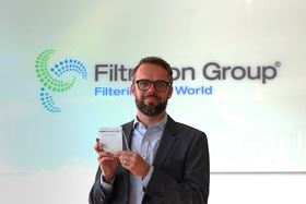Gunnar Halden, president of Filtration Group Industrial, with a prototype of the face mask. Image copyright Filtration Group GmbH.
