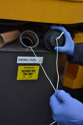 A retrieval line is attached to the Aqua-Zorb absorbent cell in a fuel tank.