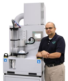 ATI's global product manager, Gautam Patel with the 100X automated filter tester and mask test adapter.