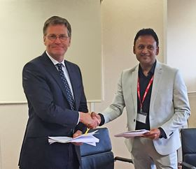 Ben Stocks, CEO of Porvair plc (left) sealing the company's joint venture agreement with Mascot.