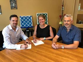 Signing the acquisition. Left to right: Graham MacDonald, Geneviève Hardy and Luc Girard.
