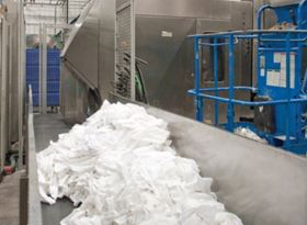 Soiled linens are sorted, laundered, then folded and prepared for distribution to more than 3500 customers.