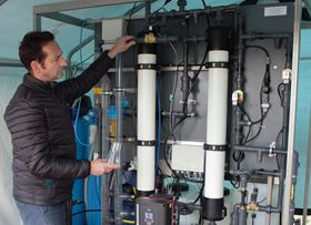 Lead scientist, Professor Darren Reynolds with the portable purification system.