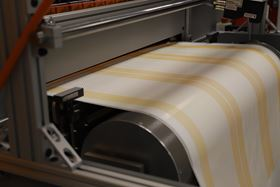 The automated system prints the feed spacer directly on to the flat sheet web.