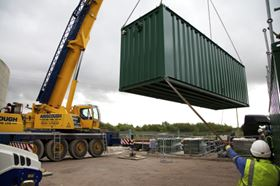 The second SAF module is lowered into position using a Hiab crane.