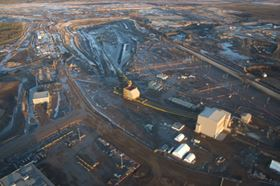 Open-cast mining of tar sands is often used for deposits at or close to the surface, followed by hot water  processing and flotation to release the oil.