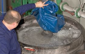 Oversize particles are discharged into a 208 litre drum.
