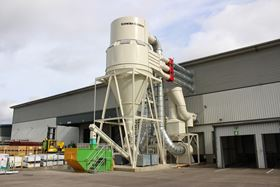 Cyclofilter dust extraction system for composite door manufacture. This return air system delivers filtered air back to the workspace to reduce heating costs.