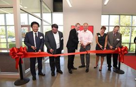 Cutting the ribbon at the opening of AAF's new Clean AIR Centre in Jeffersonville, Indiana, USA.