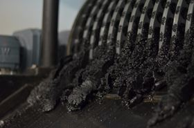 The dewatered sludge, containing all the pollutants, being scraped off the magnetic drum.