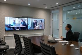 Michael Yao, Alibaba Group (right) and Astrid Nørgaard Friis and Rasmus Vad Andersen, Grundfos (on screen, left).