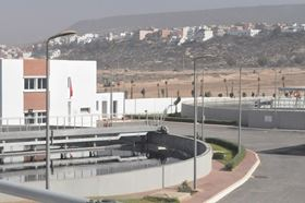 A view of the new plant featuring a clarification tank and the administration building.