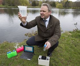Professor John Bridgeman is pictured with the 'Duo Fluor' device, which reveals unsafe sources of drinking water in less than 30 seconds (credit: John James).