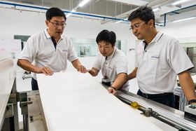 (L-R) Nano Sun founder and NTU Assoc Prof Darren Sun, engineer Zhang Lilin, and MD Wong Ann Chai doing visual inspection on a completed membrane module. Image courtesy of NTU Singapore.