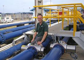 Berson's customer service manager Danny van Kuringen with some of the Berson InLine UV disinfection systems at Aruba's Balashi water treatment plant
